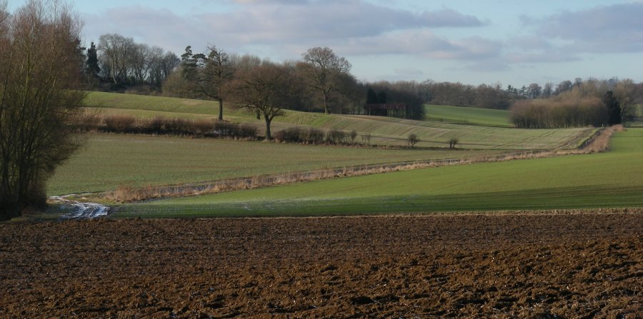 View across ploughed fields towards Benington House from the Chain Walk, east of the village of Benington.